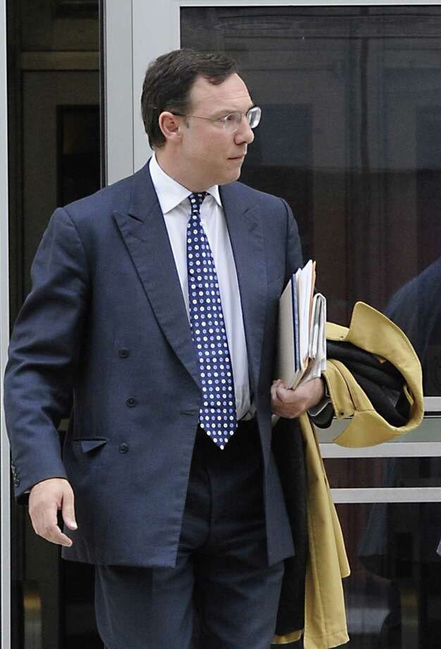 Matthew Rogers, former senior managing director for McGinn, Smith & Co. leaves the Federal Courthouse in Albany, N.Y. after pleading guilty to filing a false tax return Nov. 29, 2011, in U. S. District Court as a part of an ongoing investigation of the longtime brokerage firm. (Skip Dickstein/Times Union) Photo: Skip Dickstein / 2011