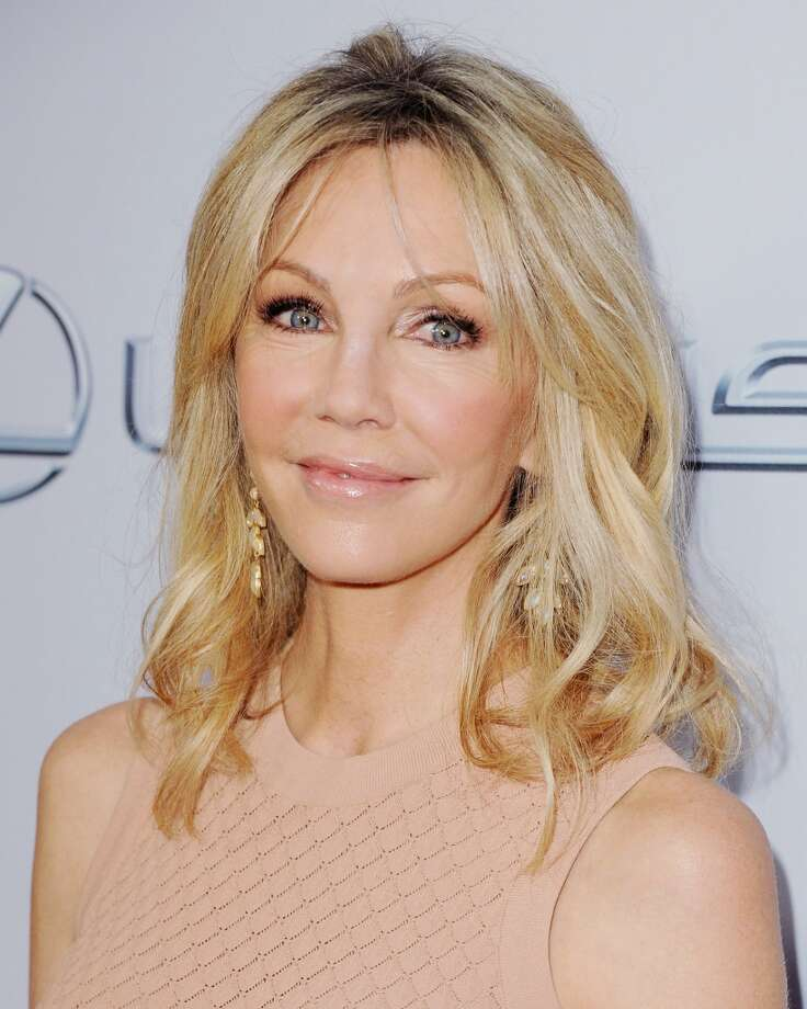 "Actress Heather Locklear arrives at the Los Angeles Premiere ""Scary Movie V\"" at ArcLight Cinemas Cinerama Dome on April 11, 2013 in Hollywood, California.  (Photo by Jon Kopaloff/FilmMagic)"