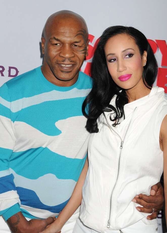 Former boxer/actor Mike Tyson and Lakiha Spicer arrive at the \'Scary Movie V\' - Los Angeles Premiere at ArcLight Cinemas Cinerama Dome on April 11, 2013 in Hollywood, California. (Photo by Jeffrey Mayer/WireImage)