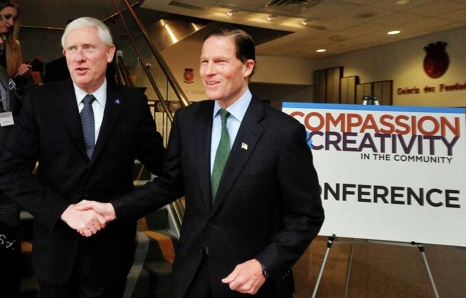 Western Connecticut State University President James Schmotter, left, shakes hands with U.S. Sen. Richard Blumenthal, keynote speaker, during a series of workshops that were part of the Compassion & Creativity in the Community conference held at the Portuguese Cultural Center in Danbury, Conn. Friday, April 12, 2013. Photo: Michael Duffy / The News-Times