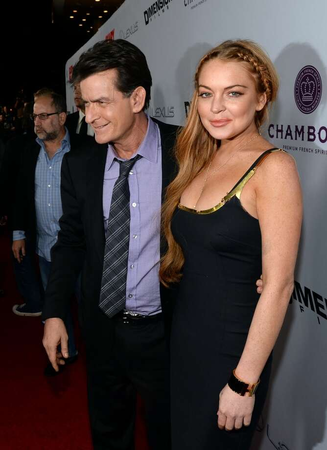 "Actors Charlie Sheen and Lindsay Lohan arrive for the premiere of Dimension Films\' ""Scary Movie 5\"" at ArcLight Cinemas Cinerama Dome on April 11, 2013 in Hollywood, California.  (Photo by Michael Buckner/Getty Images)"