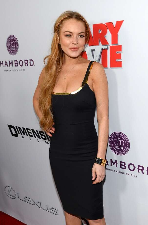 """Actress Lindsay Lohan arrives for the premiere of Dimension Films\' \""""Scary Movie 5\"""" at ArcLight Cinemas Cinerama Dome on April 11, 2013 in Hollywood, California.  (Photo by Michael Buckner/Getty Images)"""