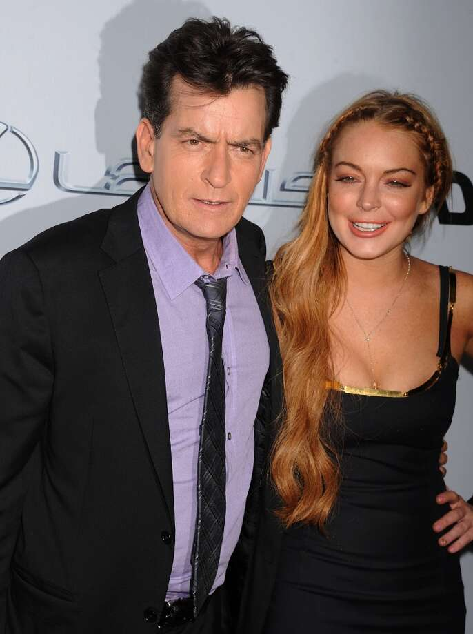Actors Charlie Sheen and Lindsay Lohan arrive at the \'Scary Movie V\' Los Angeles premiere atArcLight Cinemas Cinerama Dome on April 11, 2013 in Hollywood, California. (Photo by Jeffrey Mayer/WireImage)