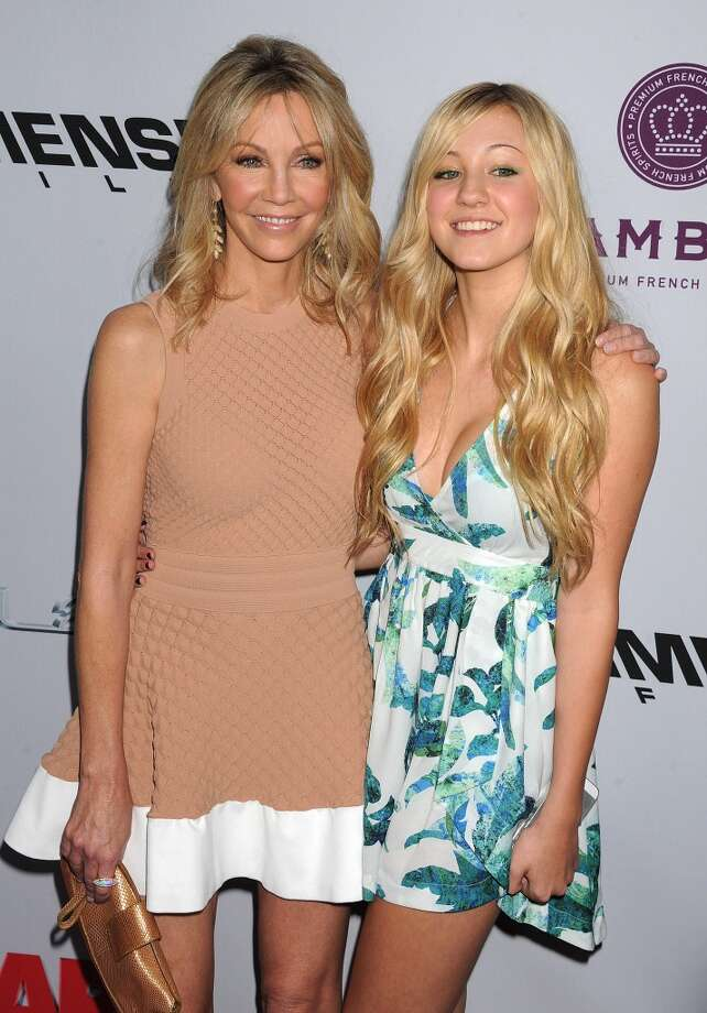 Actresses Heather Locklear and Ava Sambora arrive at the \'Scary Movie V\' Los Angeles premiere at ArcLight Cinemas Cinerama Dome on April 11, 2013 in Hollywood, California. (Photo by Jeffrey Mayer/WireImage)