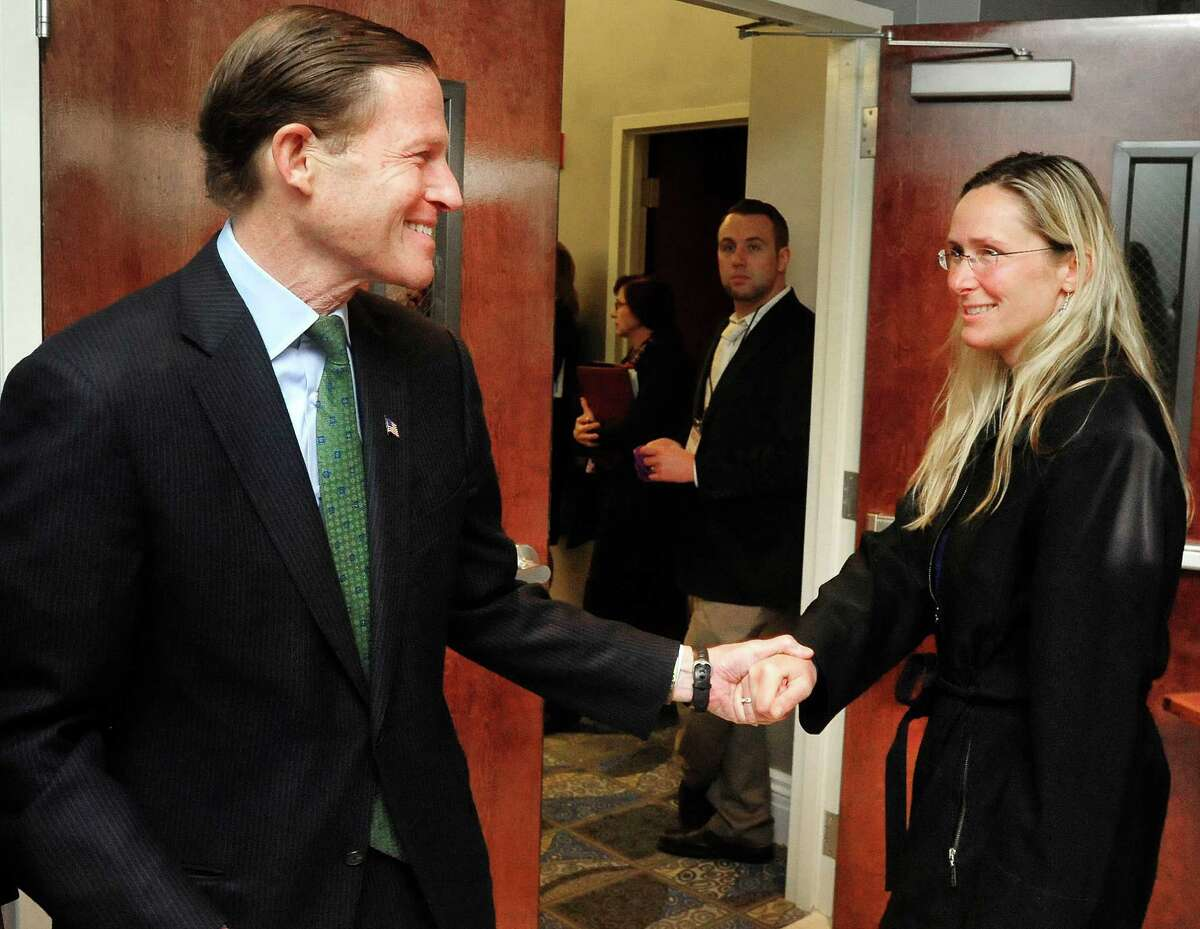 U.S. Sen. Richard Blumenthal, reaches out to Scarlett Lewis, mother of Sandy Hook School shooting victim Jesse Lewis, after a workshop that was part of the Compassion & Creativity in the Community conference held at the Portuguese Cultural Center in Danbury, Conn. Friday, April 12, 2013. Blumenthal was the keynote speaker.