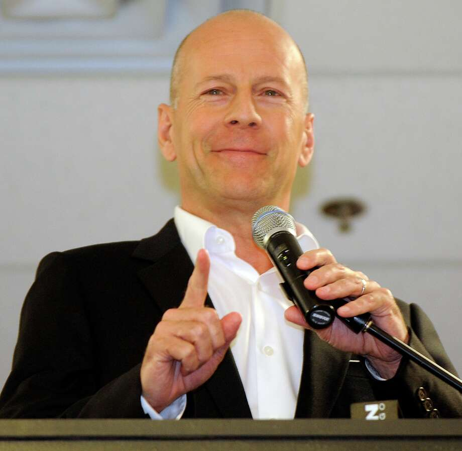 **COMMERCIAL IMAGE** In this photograph taken by AP Images for Sobieski, Sobieski Vodka global brand ambassador Bruce Willis offers a toast of Sobieski Vodka for charity at Binny's in Chicago on Wednesday, Aug. 11, 2010. (David Banks/ AP Images for Sobieski) Photo: David Banks / AP Images