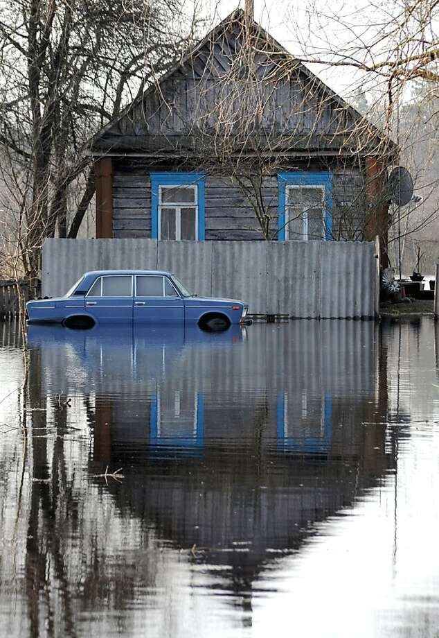 Belarus' wet spring:Shin-deep water floods a street in the village of Vereshitsa near the Pripyat River, about 200 miles south of Minsk. Photo: Viktor Drachev, AFP/Getty Images