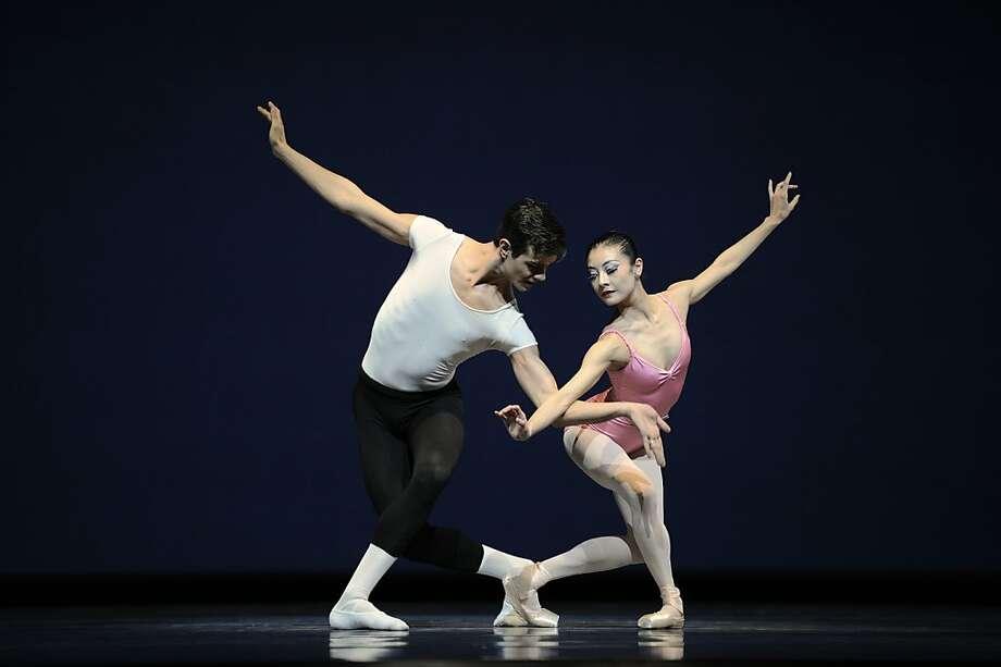 San Francisco Ballet's Yuan Yuan Tan and Vito Mazzeo in Balanchine's Symphony In Three Movements. Photo: Erik Tomasson© Erik Tomasson©, SF Ballet