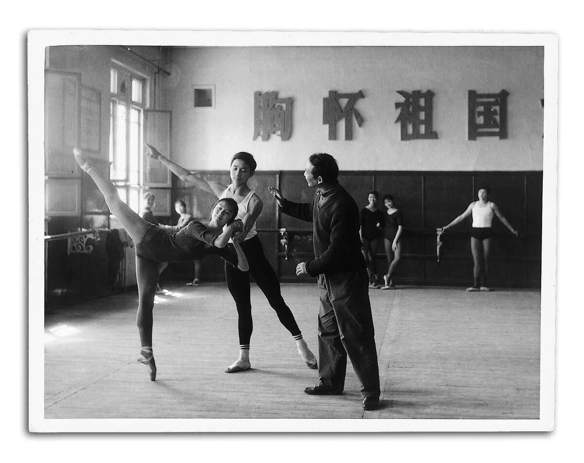 Li Cunxin, 17, with teacher Zhang Shu at Madame Mao's Bejing Dance Academy, 1977