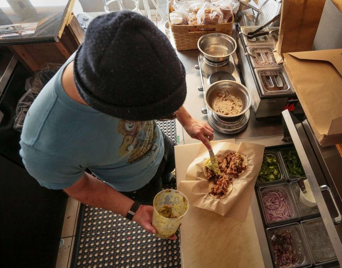 Jesse Wynn makes the Chomp Tacos at Chomp N Swig.