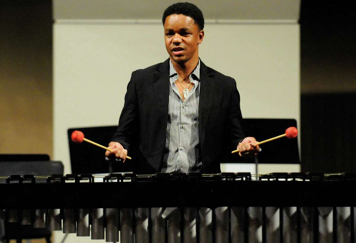 1991 Albany High School graduate and four-time grammy nominee jazz vibraphonist Stefon Harris, seated at piano, runs a jazz work shop for his alma mater's jazz ensemble at the school in Albany, NY Friday, Dec.9, 2011.( Michael P. Farrell/Times Union)