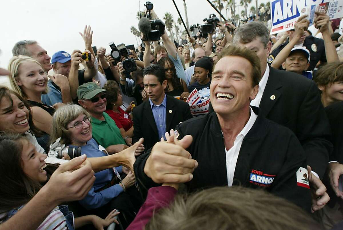 RECALL242_MJM.jpg Arnold Schwarzenegger works the crowd after his speech. Arnold Schwarzenegger and his wife Maria Shriver at the Huntington Beach Pier. On the day before elections, Arnold Schwarzenegger charters a jet to rallies throughout California starting in San Jose and ending in LA. Event on 10/6/03 in Huntington Beach. MICHAEL MALONEY / The Chronicle