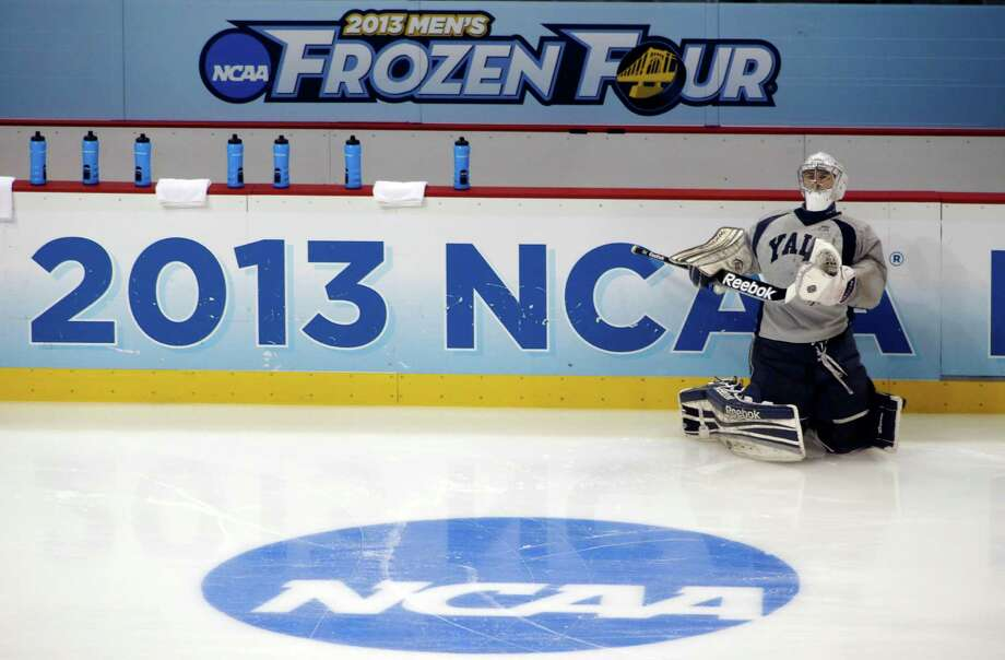 Yale's goalie Nick Maricic stretches during the team's practice session for the Frozen Four NCAA college hockey championship on Friday, April 12, 2013, in Pittsburgh. Yale plays Quinnipiac in the championship game on Saturday. Photo: Keith Srakocic