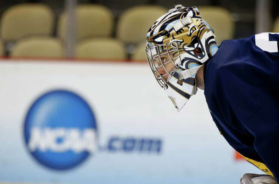 Quinnipiac goalie Eric Hartzell watches during NCAA college hockey practice at the Frozen Four, Friday, April 12, 2013, in Pittsburgh. Quinnipiac plays Yale in the championship game on Saturday. Photo: Keith Srakocic