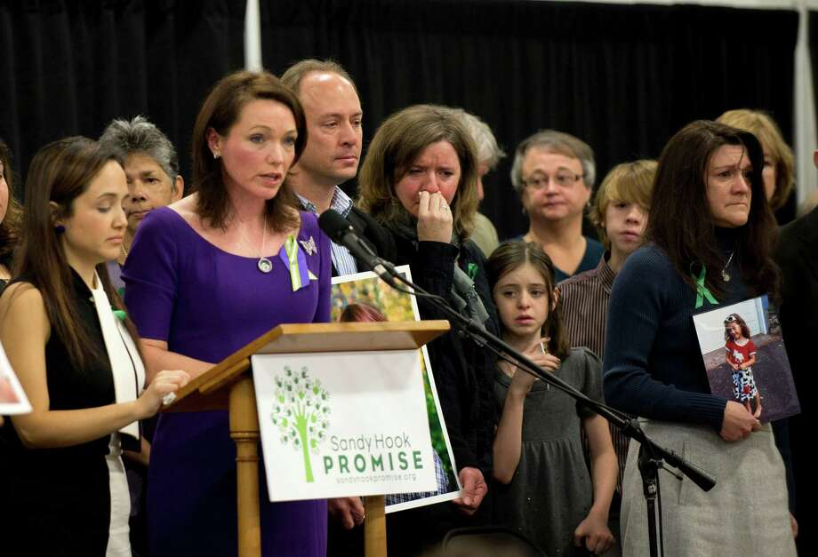 Family members of victims of the Sandy Hook Elementary School shooting attend a news conference January 14, 2013 in Newtown, Connecticut. Families of victims asked that there be a dialogue to find solutions on how to prevent similar future violence. AFP PHOTO/DON EMMERT        (Photo credit should read DON EMMERT/AFP/Getty Images) Photo: DON EMMERT, AFP/Getty Images / 2013 AFP