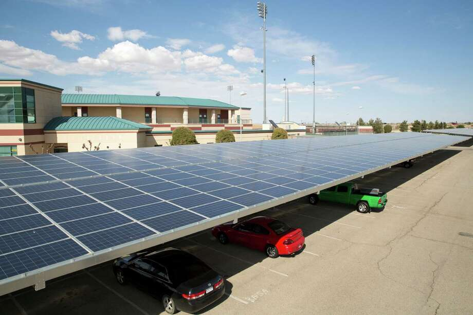 Solar panels have been installed on top of parking shade structures at Clear Channel Stadium in Lancaster, Calif., part of the city's pursuit of solar self-sufficiency. Photo: MONICA ALMEIDA, STF / NYTNS