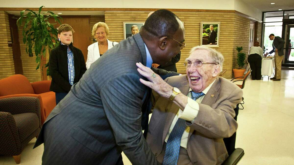Victor Ilegdobu, M.D., left, says hello to James Steele, M.D., before Steele, who's turning 100 today, gives a lecture in the University of Texas, Houston School of Public Health, Tuesday, April 2, 2013, in Houston. Ilegdobu says he was a student under Steele in 1982 and calls Steele his instructor, advisor, father, everything. ( Nick de la Torre / Chronicle )