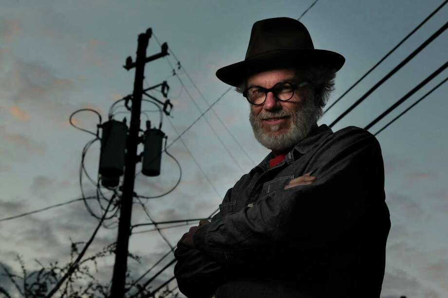 "Randy Twaddle says his work about power lines is really about paying attention: ""If you can look at something - anything - and pay attention, you experience eternity."" Photo: Mayra Beltran, Staff / © 2013 Houston Chronicle"