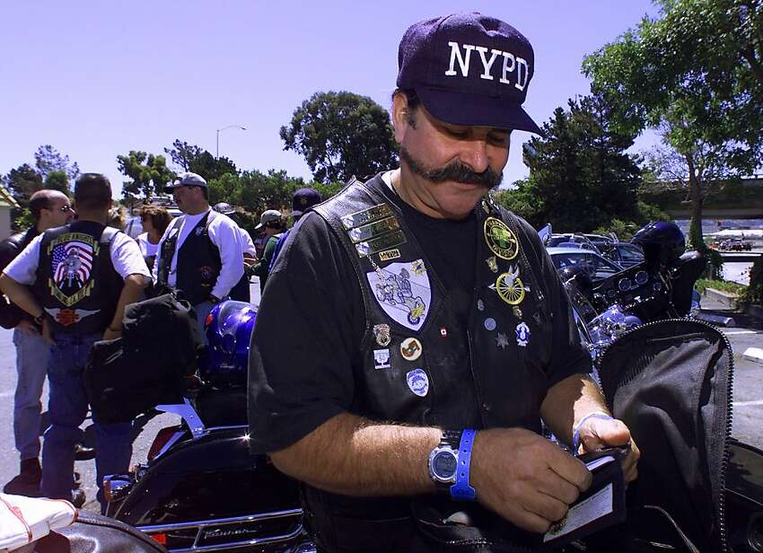 Vice president Michael Wozniak, of the Bay Area chapter of the Blue Knights, gets ready for a pilgrimage from San Mateo to Sacramento, in memory of fallen officers from around the state.