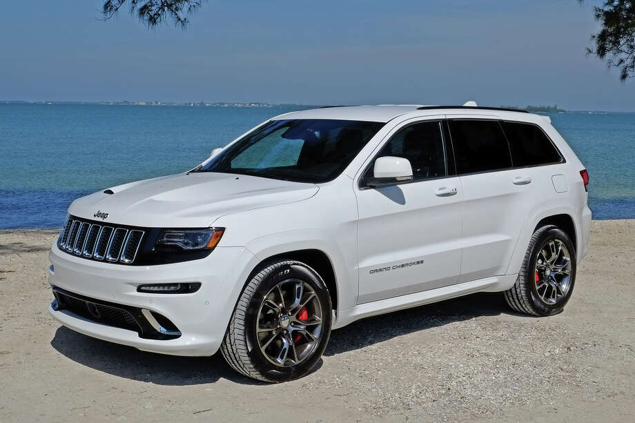 three jeep front june quarter grand news products automobile magazine drive cherokee first