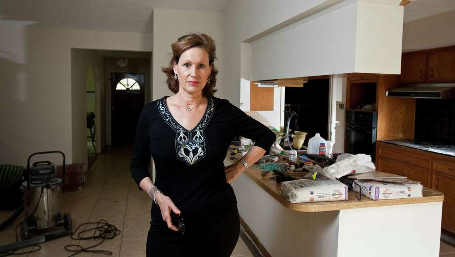 Barbara Aksamit, who flips foreclosures, does everything from refurbishing floors to owner-financing the sales. Photo: Nick De La Torre, Staff / © 2013 Houston Chronicle