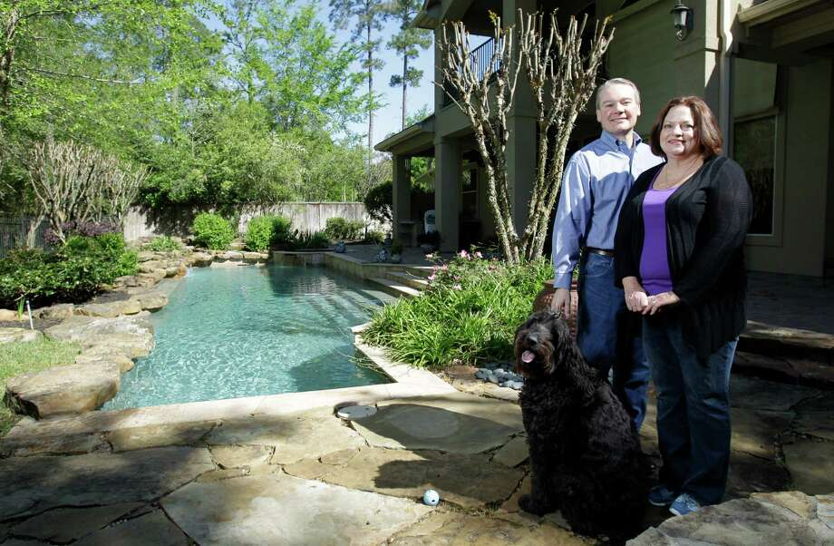 Richard and Kathleen Wolff, and their dog, Figaro, wanted to live in The Woodlands because he works for Exxon Mobil Corp. Photo: Melissa Phillip, Staff / © 2013  Houston Chronicle
