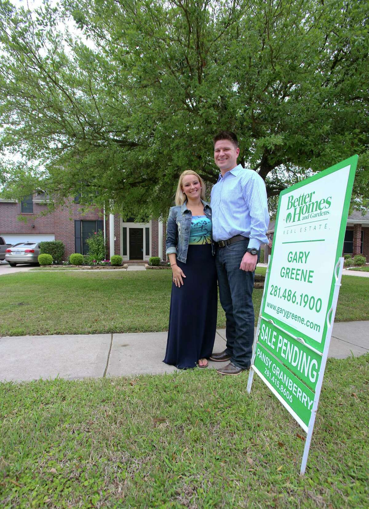 4/9/13: Nathan Cloutier age 33 and girlfriend Christina Aten age 28 in front of their newly purchased home in Pearland, Texas. Nathan is part of a young generation of buyers that are taking the leap into homeownership The two moved from an apartment in Clear Lake, Texas.