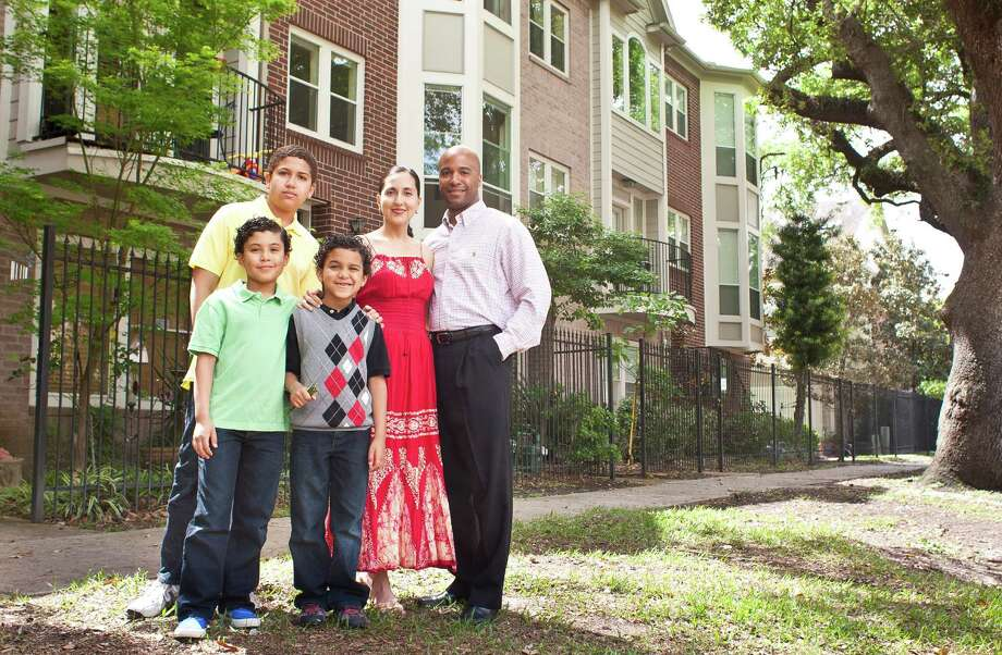 The Lewis family, Miles, 13, Marcus, 10, Mateo, 7, Cynthia Aceves-Lewis and Michael Lewis, are about to list their Midtown home. Photo: Nick De La Torre, Staff / © 2013 Houston Chronicle