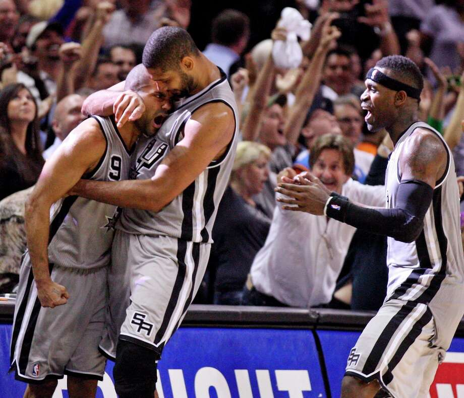 The Spurs' Tony Parker (from left) is congratulated by teammates Tim Duncan and Stephen Jackson after making a game-winning basket against the Oklahoma City Thunder on Thursday, Nov. 1, 2012 at the AT&T Center. The Spurs won 86-84. Photo: Edward A. Ornelas, San Antonio Express-News / © 2012 San Antonio Express-News