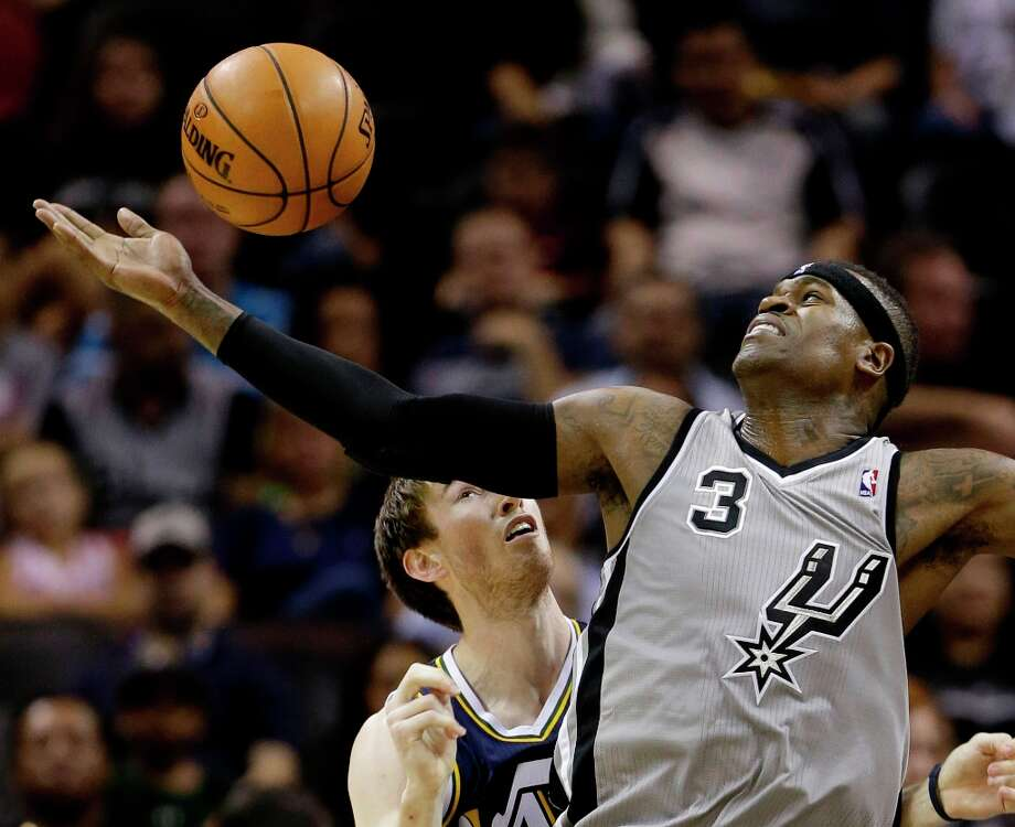 The Spurs' Stephen Jackson (3) loses control of the ball as he is defended by Utah Jazz' Gordon Hayward, left, during the second quarter Saturday, Nov. 3, 2012, in San Antonio. San Antonio won 86-84. Photo: Eric Gay, Associated Press