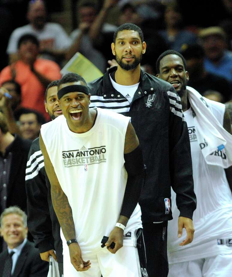 Patty Mills (left), Stephen Jackson, Tim Duncan and Eddy Curry of the Spurs react as teammate Nando De Colo sinks the winning shot as the Spurs beat Atlanta 101-99 during preseason NBA action at the AT&T Center on Wednesday, Oct. 10, 2012. Photo: Billy Calzada, San Antonio Express-News / © San Antonio Express-News
