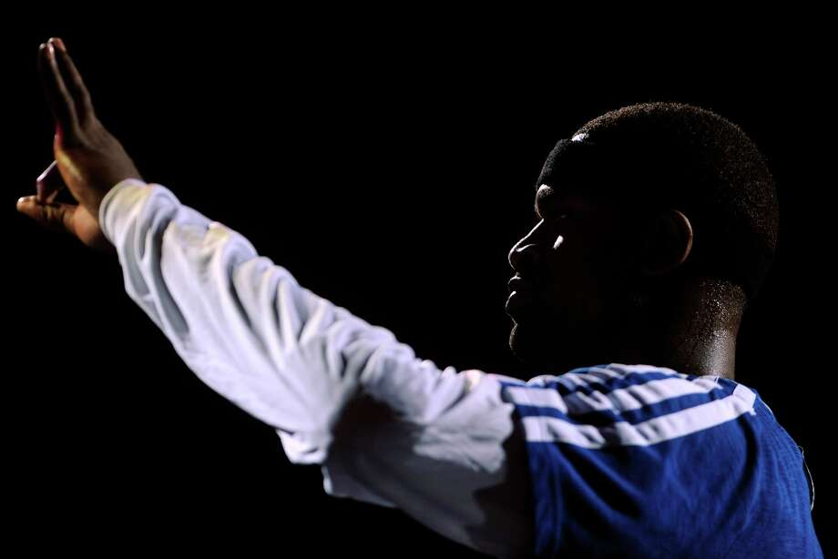 Stephen Jackson of the Spurs gestures after being introduced against the Phoenix Suns at the AT&T Center on Saturday, Jan. 26, 2013. Photo: Billy Calzada, San Antonio Express-News / SAN ANTONIO EXPRESS-NEWS