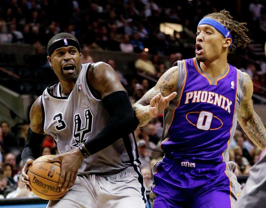 The Spurs' Stephen Jackson (3) drives past Phoenix Suns' Michael Beasley (0) during the first quarter Saturday, Jan. 26, 2013, in San Antonio. Photo: Eric Gay, Associated Press