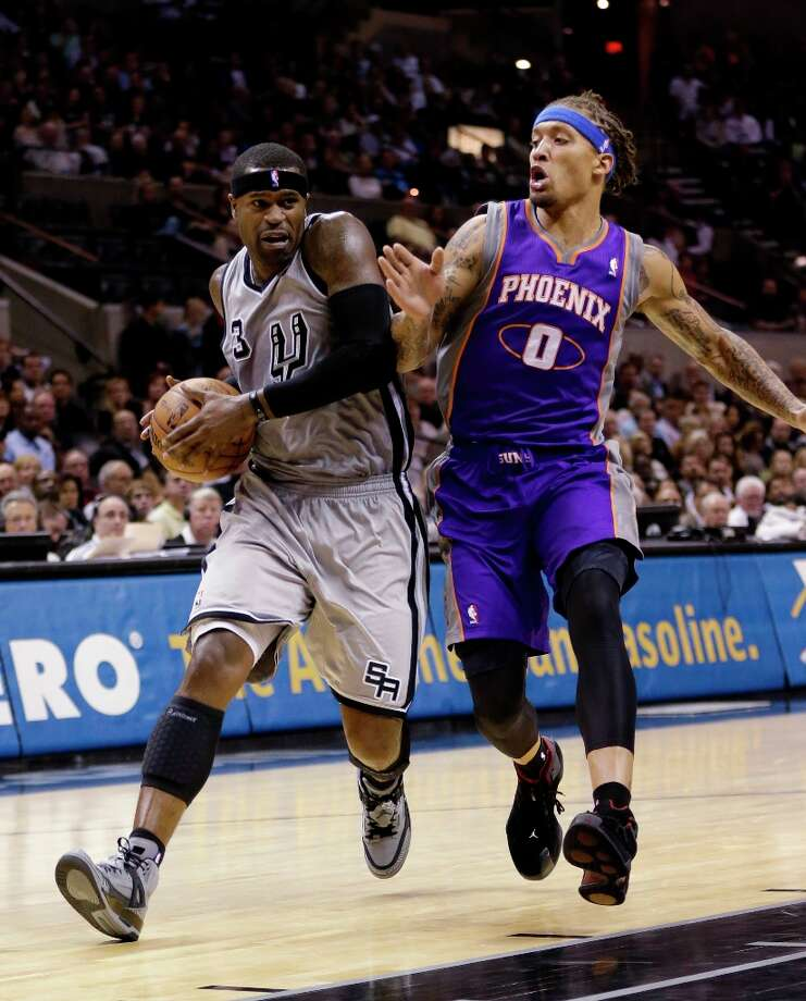 The Spurs' Stephen Jackson, left, is defended by Phoenix Suns' Michael Beasley, right, during the first quarter Saturday, Jan. 26, 2013, in San Antonio. Photo: Eric Gay, Associated Press