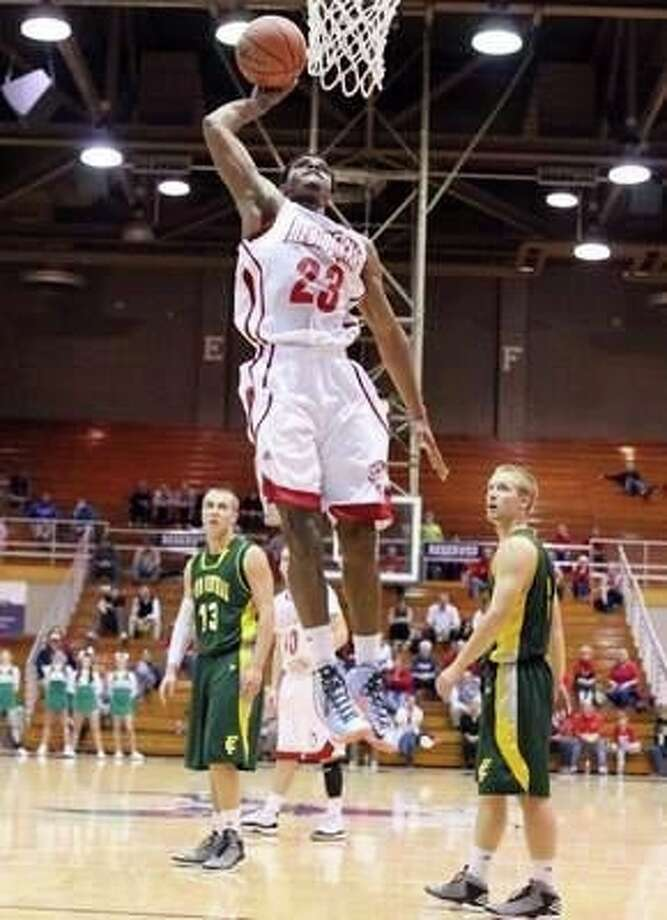 Lamar basketball commitment Darryl Baker rises for a dunk in his senior season at Jeffersonville High School in Indiana. Photo: Facebook