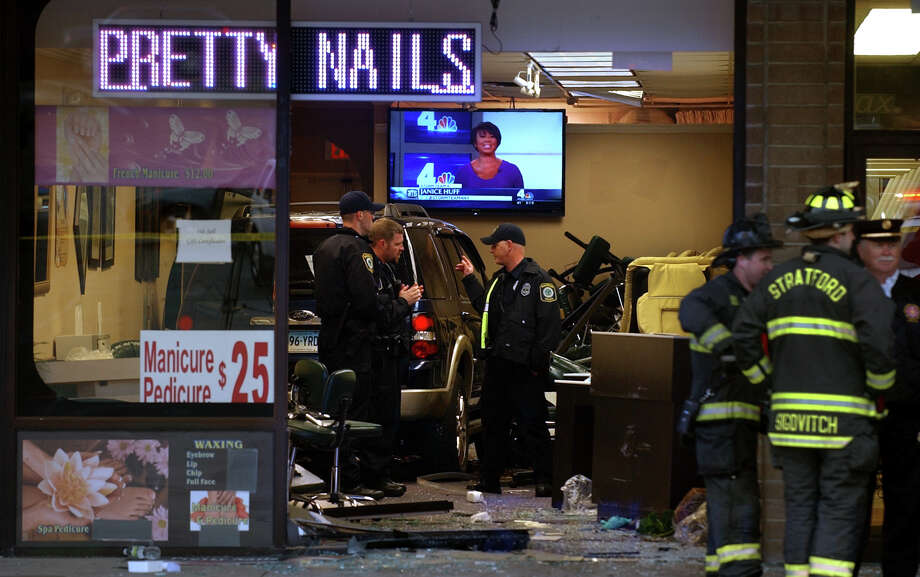 Police invetigate how a SUV managed to crash into the Pretty Nails salon in the Stratford Square shopping center on Friday afternoon April 12, 2013. Several customers and workers in the store were injured. Photo: Christian Abraham / Connecticut Post