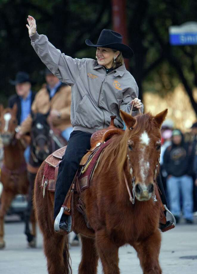 Former U.S. Sen. Kay Bailey Hutchison's book about pioneering Texas women will be published Tuesday. A pioneer in her own right, she displays her state spirit in a Houston Livestock Show and Rodeo parade. Photo: Steve Campbell, FRE / AP2010