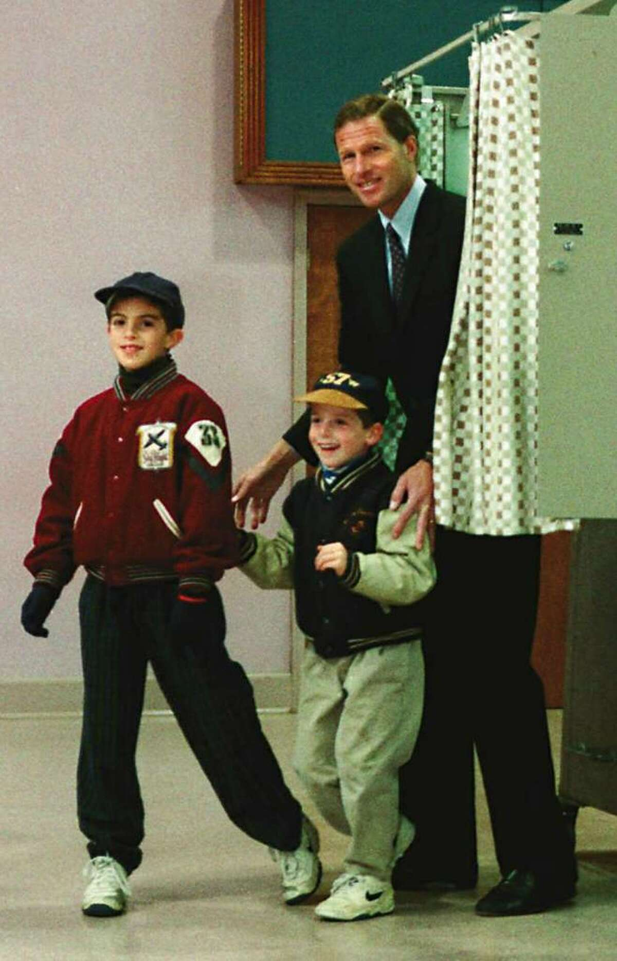 State Attorney General Richard Blumenthal and his sons, Matthew, 8 and Michael, 5, leave the booth after voting in Stamford on Nov. 8th, 1994.