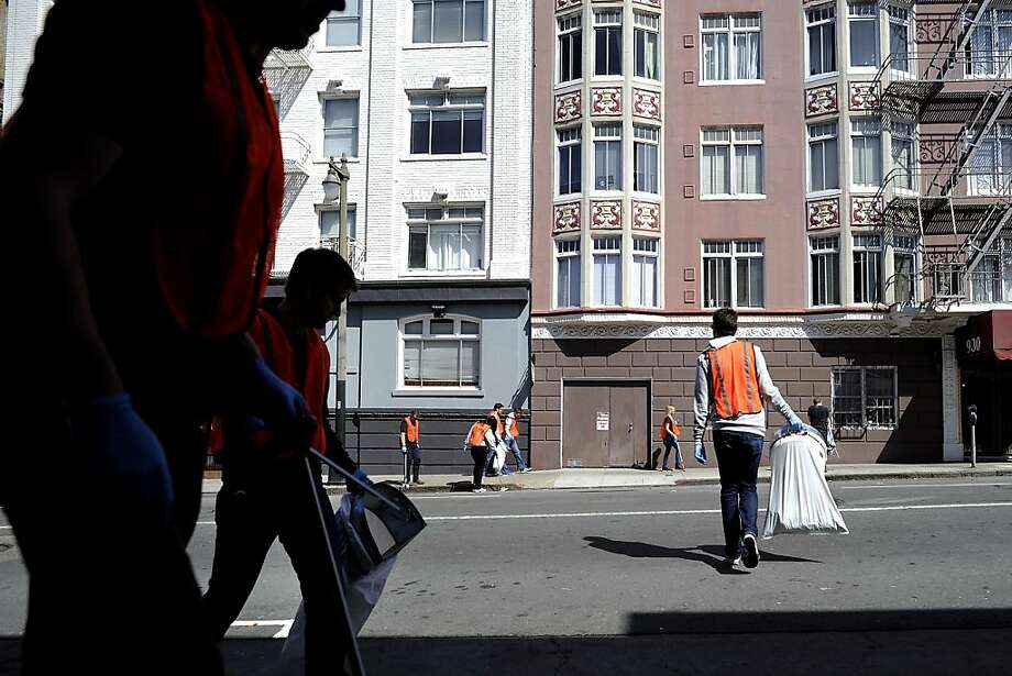 Employees of new San Francisco tech firms pick up trash around the Mid-Market and Tenderloin streets. Photo: Michael Short, Special To The Chronicle