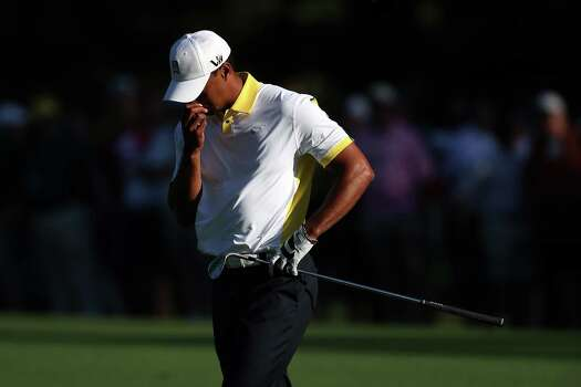 AUGUSTA, GA - APRIL 12:  Tiger Woods of the United States reacts after hitting the flag and going into the water on the15th hole during the second round of the 2013 Masters Tournament at Augusta National Golf Club on April 12, 2013 in Augusta, Georgia. Photo: Andrew Redington, Getty Images / 2013 Getty Images