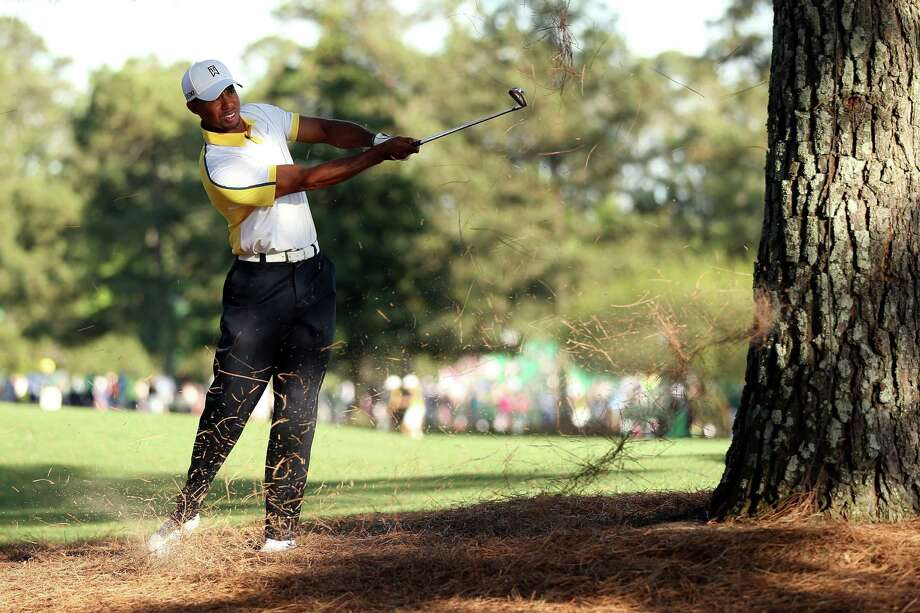 AUGUSTA, GA - APRIL 12:  Tiger Woods of the United States hits a shot on the 15th hole during the second round of the 2013 Masters Tournament at Augusta National Golf Club on April 12, 2013 in Augusta, Georgia. Photo: Andrew Redington, Getty Images / 2013 Getty Images