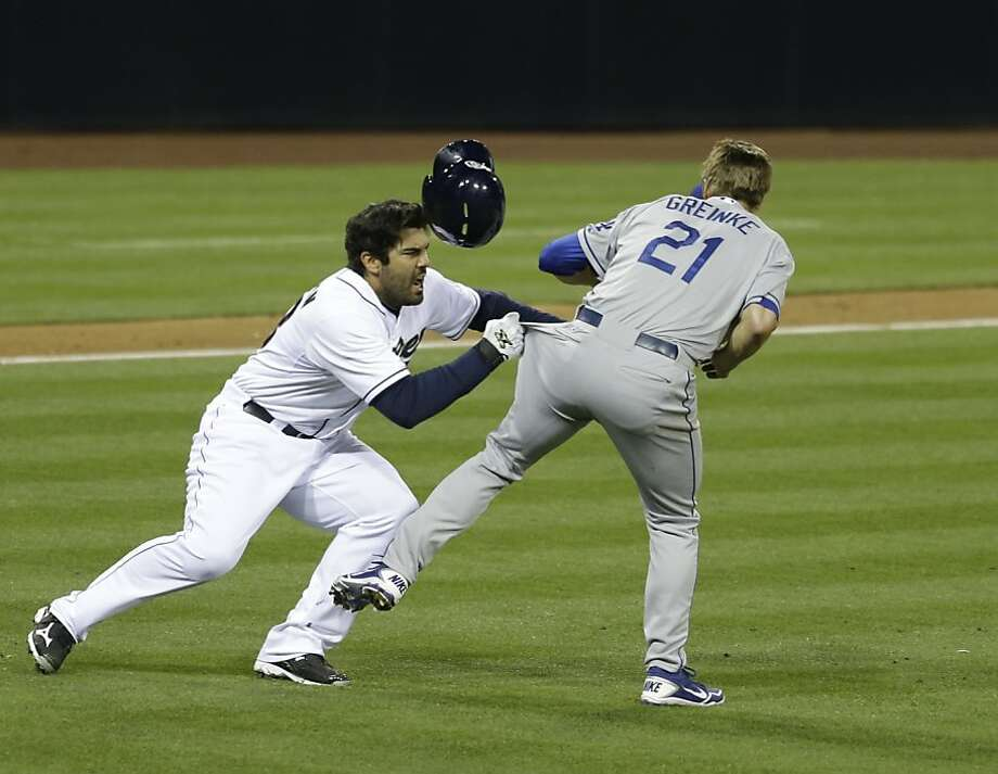 Zack Greinke (right) is expected to miss two months after a fight with Carlos Quentin (left). Photo: Lenny Ignelzi, Associated Press