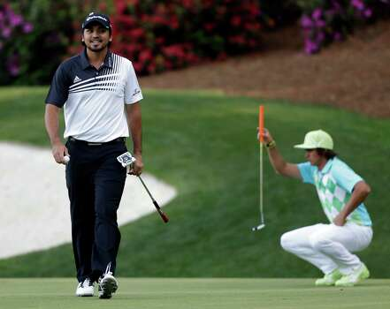 Rickie Fowler, right, lines up his putt as Jason Day, of Australia, walks off the 13th green during the second round of the Masters golf tournament Friday, April 12, 2013, in Augusta, Ga. (AP Photo/David Goldman) Photo: David Goldman, Associated Press / AP