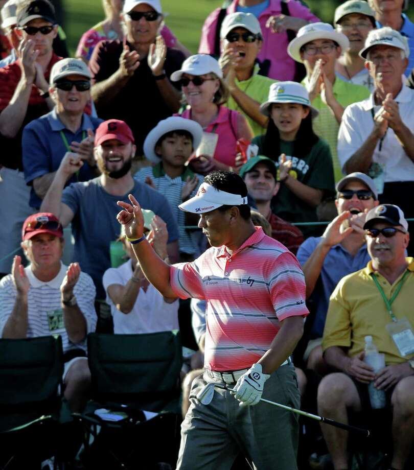 K.J. Choi, of South Korea, waves to the gallery after his chip shot to the 18th green during the second round of the Masters golf tournament Friday, April 12, 2013, in Augusta, Ga. (AP Photo/David J. Phillip) Photo: David J. Phillip, Associated Press / AP