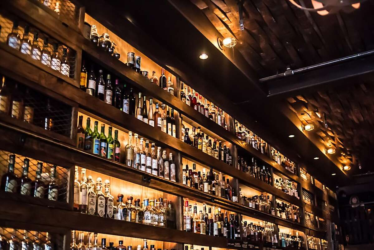 The collection of top shelf spirits behind the bar at Rickhouse.
