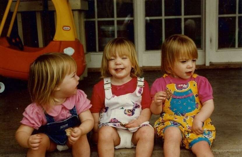 Then: Meghan Thompson (from left) and twin sisters Allison and Meredith Henry were just 2 in