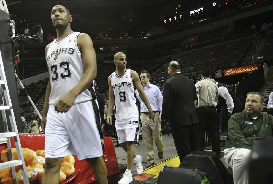 Spurs\' Boris Diaw (33) and Tony Parker (09) head onto the court for team photos before their game against the Sacramento Kings at the AT&T Center on Friday, Apr. 12, 2013.