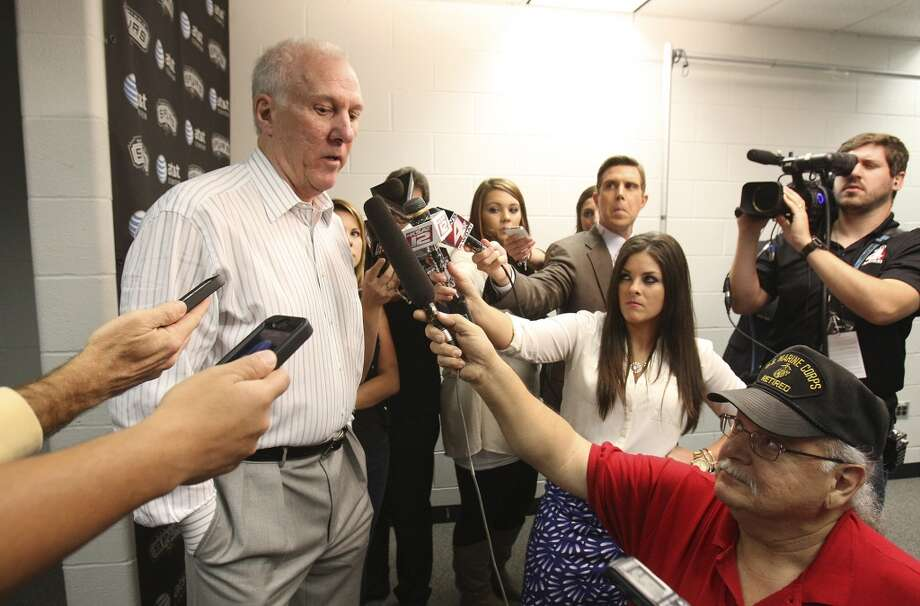 Spurs head coach Gregg Popovich talks to media regarding the waiving of forward Stephen Jackson before their game against the Sacramento Kings at the AT&T Center on Friday, Apr. 12, 2013.