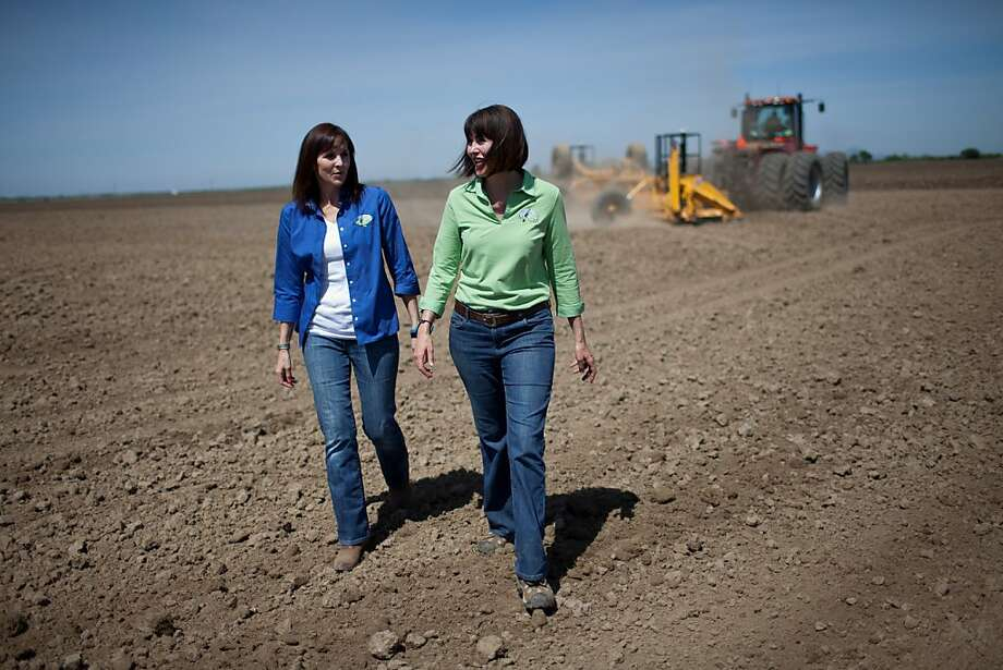 Sisters Michelle Vogt (left) and Nicole Montna Van Vleck are the third generation to run their family rice farm in Yuba City (Sutter County). They have also protected the land so it will remain in use as a farm and a bird habitat. Photo: Max Whittaker/Prime, Special To The Chronicle