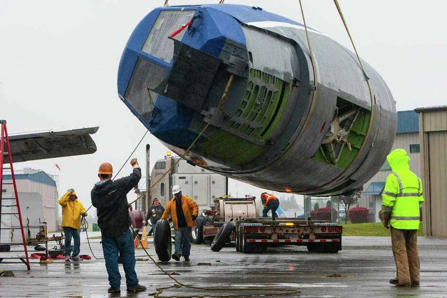 Workers and volunteers help to load in a section of a mockup of the Boeing SST (Super Sonic Transport) Friday, April 12, 2013, to the Museum of Flight Restoration Center in Everett. Only two intact pieces - the nose and the center segment - from the original mockup remain. In the late 1960s, the federal government selected Boeing to build the country's first supersonic transport. Photo: JORDAN STEAD / SEATTLEPI.COM